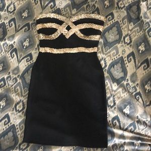 Strapless black and gold dress